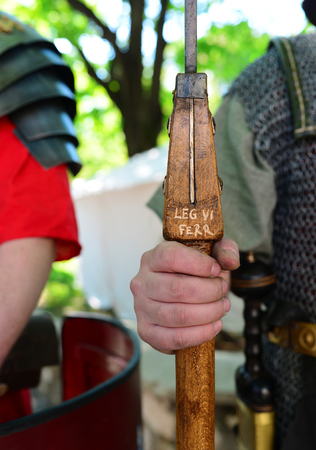 Roman empire soldier holding a spear handle detail