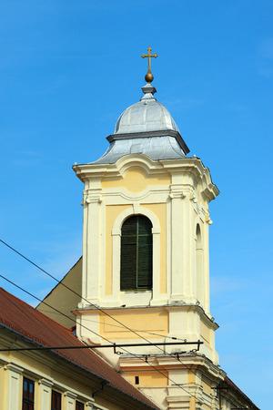 Timisoara city Romania Church of the Misericordian Monks tower landmark Banco de Imagens