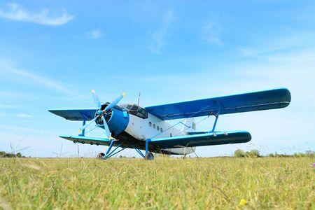 small utilitarian airplane detail at aerodrome with blue sky Фото со стока