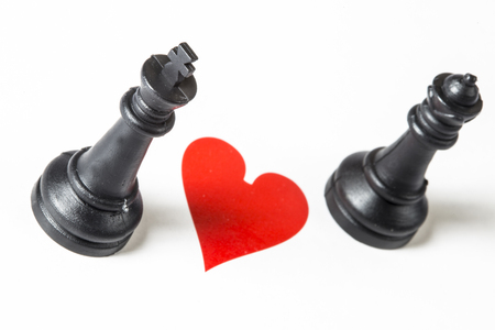 king and queen of hearts: heart between chess