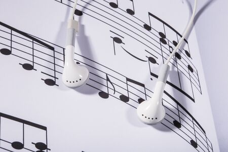 sheet music: sheet music and earphones Stock Photo