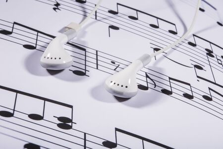 earbud: sheet music and earphones Stock Photo