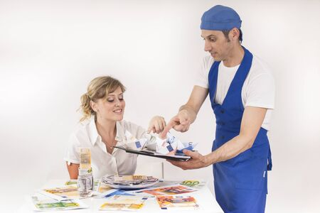 serves: chef serves a meal of banknotes to a young manager Stock Photo