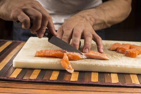 fishmonger: fishmonger prepares a fillet salmon Stock Photo
