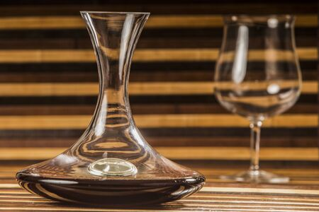 decanter: decanter and glass with red wine