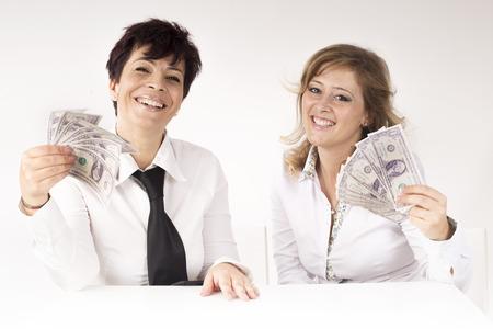 ganancias: socios muestra billetes de banco ganancias Foto de archivo