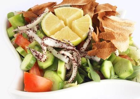 arabian food: Fattoush - Lebanese Salad isolated on white background