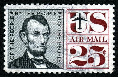 postage stamp: Vintage Abraham Lincoln USA 25c Airmail postage stamp.