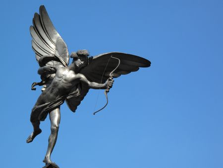 greek mythology: The aluminium statue of Eros the greek mythological  God Of Love, stands at the top of The Shaftesbury Memorial Fountain in Londons Piccadilly Circus