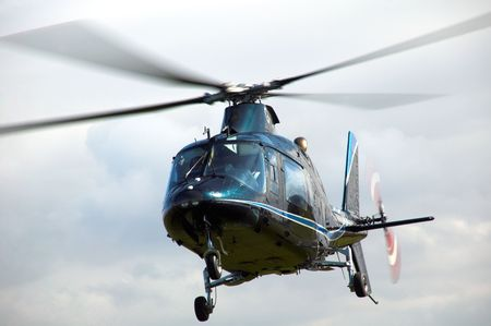 Blue Helicopter hovering in flight photo
