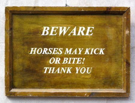might: Beware horses might bite and kick sign. Stock Photo