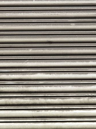 Metal shutter protecting a business photo
