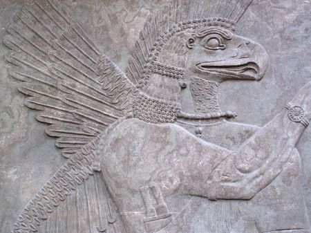 Assyrian relief 865-860 BC, showing an eagle-headed protective spirit