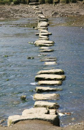 Stepping stones crossing a Welsh stream Stock Photo - 5192648