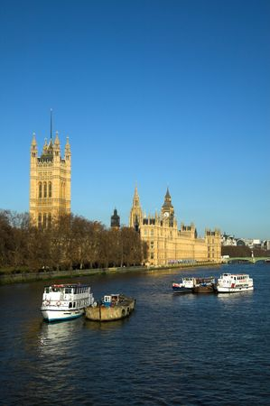 neo gothic: Early morning at The Houses Of Parliament which were built on the site of The Royal Palace Of Westminster in a neo Gothic style after a fire in 1834, they had become the seat of government in 1547. Stock Photo