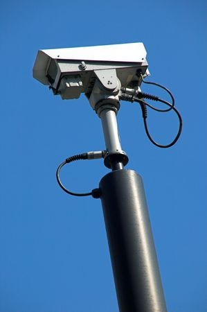 Security camera being used for surveillance with a blue clear sky. Stock Photo - 5286727