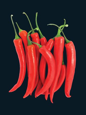 Red hot chilli peppers on black background  photo