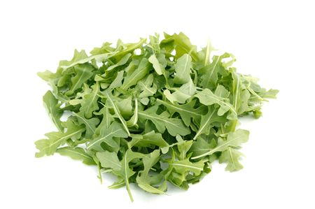 Wild Rocket in a heap isolated on a white background photo