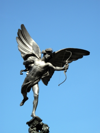 The aluminium statue of Eros the greek mythological  God Of Love, stands at the top of The Shaftesbury Memorial Fountain in Londons Piccadilly Circus