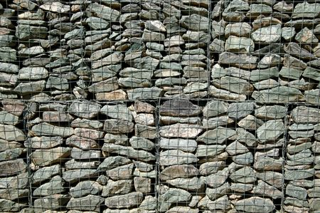 Gabion wall caged stones textured background photo