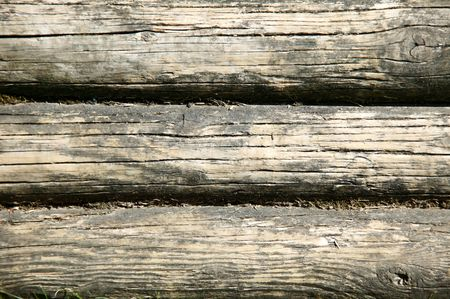 logging industry: Old wooden logs macro background.