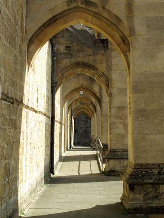 typically english: Buttress arches of Winchester Cathedral. Winchester Cathedral was originally founded in 642  and is one of the largest cathedrals in England and is the seat of the Bishop of Winchester.