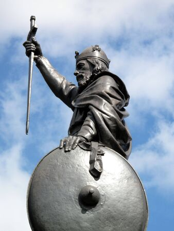 King Alfred The Greats statue designed by Hamo Thornycroft and erected in 1899 stands at the eastern  end of the Broadway in Winchester England photo