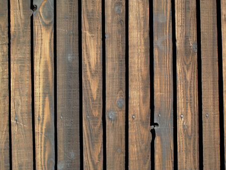 Old wooden brown fence. photo