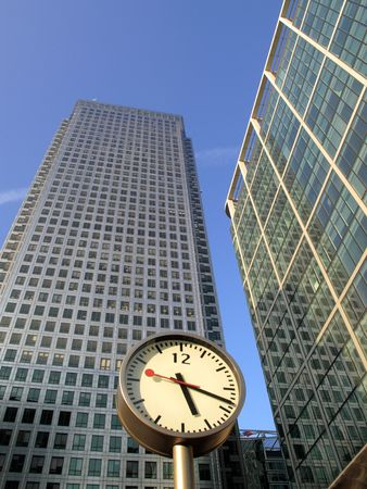 docklands: Time is money in Docklands Canary Wharf which is the largest business development in East London, built on the site of the old West India Docks on the Isle Of Dogs Stock Photo