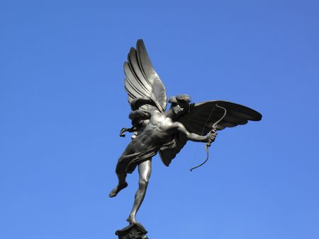 shaftesbury: The aluminium statue of Eros the greek mythological  God Of Love, stands at the top of The Shaftesbury Memorial Fountain in Londons Piccadilly Circus