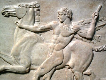 Roman marble relief AD125 of a naked youth with his horse and dog, found  at Emperor Hadrian's villa in Tivoli Stock Photo - 5776795