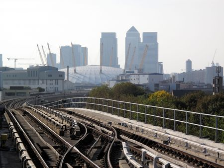View from a Docklands Light Railway station of Canary Wharf in Docklands and the Millennium Dome. photo