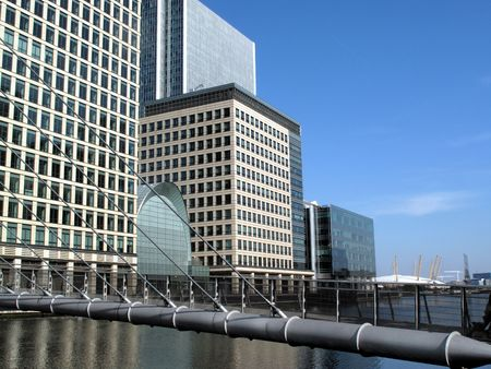 Footbridge to work in Canary Wharf in Londons Docklands. Canary Wharf in Docklands is the largest business development in East London, built on the site of the old West India Docks on the Isle Of Dogs photo