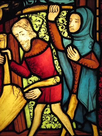 stained glass panel: Part of a medieval stained glass panel from about 1375 detailing Christs entry into Jerusalem. The figure on the left is holding a garment to welcome Christ and the figure on the right is holding a palm leaf.