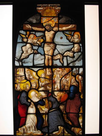 stained glass panel: The Crucifixion of Christ shown in an image on a medieval 16th century stained glass panel from the cloisters of Steinfeld Abbey near Cologne Germany Stock Photo
