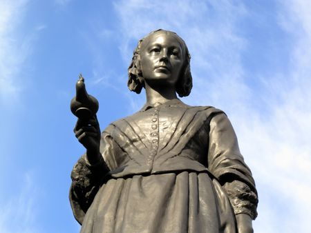 statistician: Victorian memorial statue of Florence Nightingale 1820-1910 an English nurse known as the lady with the lamp, who cared for wounded soldiers in the Crimean War.