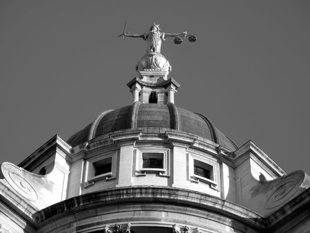 The Central Criminal Court fondly known as The Old Bailey, which until 1902 was Newgate prison is the highest  court for Criminal cases in England, the picture is shown as a monochrome black & white photo