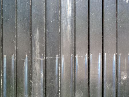 Old distressed  grey painted  wooden fence photo
