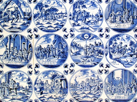 delftware: Close -up of Antique tin glazed blue Delft wall tiles dating from 1750-80, showing biblical scenes