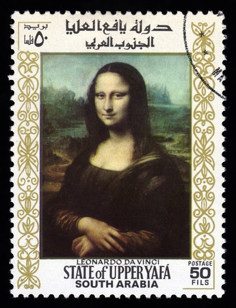 postage stamp: Upper Yafa, South Arabia postage stamp with a portrait image of the smiling Mona Lisa by the medieval Renaissance artist and inventor Leonardo Da Vinci