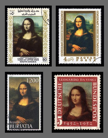 mona lisa: Collection of  postage stamp with a portrait image of the smiling Mona Lisa by the medieval Renaissance artist and inventor Leonardo Da Vinci