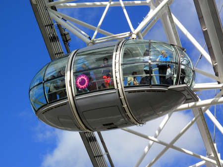 millennium wheel: London, United Kingdom – Sep 12, 2010: A Pod of The London Eye in Londons Westminster full  of tourists enjoying a the view Editorial