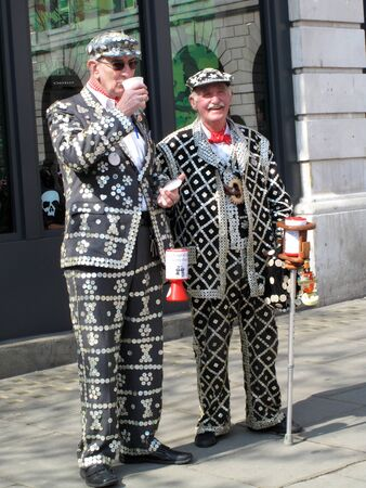 nacr�: London, United Kingdom, Apr 19, 2009 : Pearly Kings collecting for charity in Londons Covent Garden a practise  first associated with Henry Croft an orphan street cleaner who collected for charity and wore the first known Pearly costume