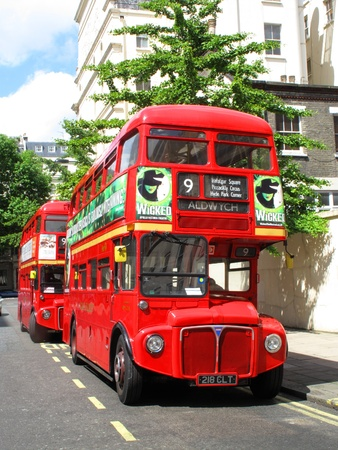 London, England, UK – June 7, 2009. No 9 London Routemaster red double decker buses parked up at a bus stand, before starting their journey across London to Aldwych one of two remaining heritage routes. The Routemaster is a profitable fare paying touris