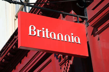 britannia: London, United Kingdom, Mar 19, 2011 : Britannia Building Societys red sign hanging outside one of its branches in the City of London