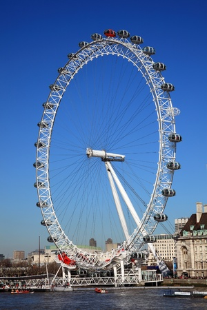 London, United Kingdom, Mar 19, 2011 : The London Millennium Eye in Westminster on the banks of the Thames river in London, is Europes largest Ferris wheel, and the most popular paid tourist attraction in the United Kingdom
