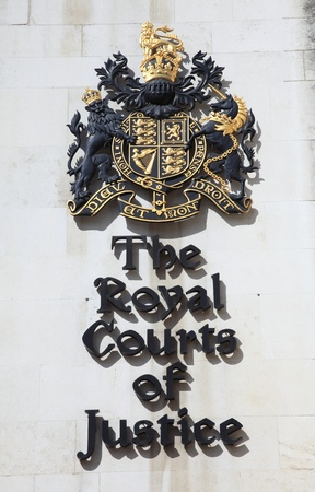 London, United Kingdom, Apr 9, 2011 : The Royal Courts Of Justice sign with the Crown's coat of arms placed at the entrance of the courthouse