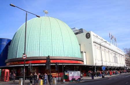 London, United Kingdom, Mar 12, 2011 : Tourists forming a large queue outside Madame Tussauds to see the exhibitions at the waxworks and planetarium