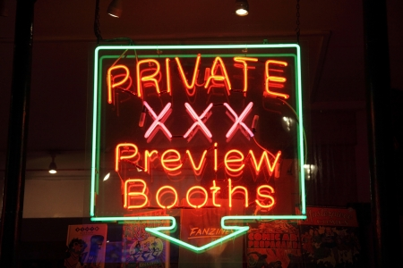 London, United Kingdom, Jan 23, 2011 : Neon sign of an adult licensed sex shop at night in a red light district advertising private preview booths Stock Photo - 9541760