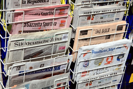 London, United Kingdom, Apr 24, 2011 : International newspapers displayed outside a newsagents shop in Kensington for sale to tourists